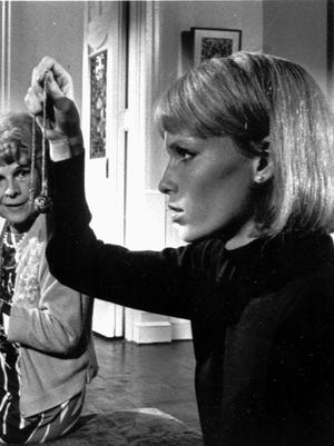 Mia Farrow, right, Ruth Gordon, center, and Patsy Kelly appear in a scene from the 1968 movie, 'Rosemary's Baby.'
