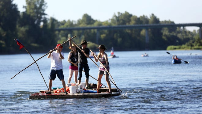 Kayaks, canoes and homemade watercraft take to the water as the Great Willamette River Raft Race shoves off from Riverview Park in Independence Aug. 8.