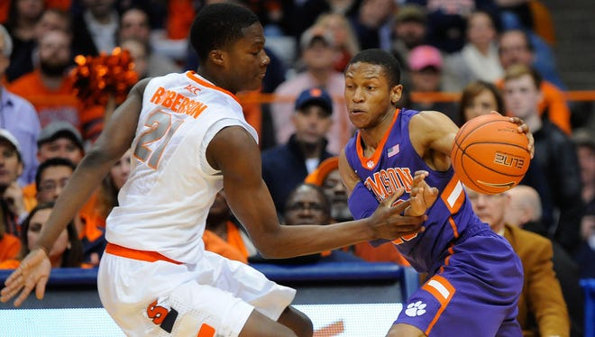 Clemson Tigers guard Jordan Roper (R) drives to the basket against the defense of Syracuse Orange forward Tyler Roberson (L) during the first half at the Carrier Dome.