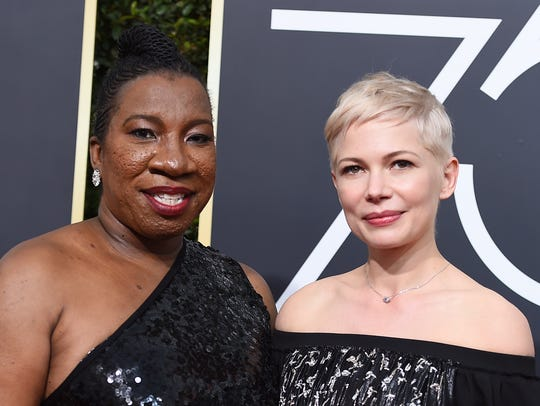 Tarana Burke, left, and Michelle Williams arrive at