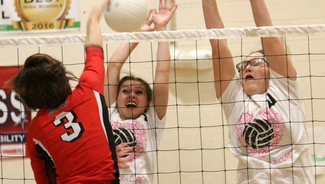 Eunice's Bailey Kimble spikes a ball toward Cloudcroft's Sabina Judah, left, and Diana Cook during pool play of the 33rd annual Mountain Top tournament Friday afternoon at the Cloudcroft High School gym.