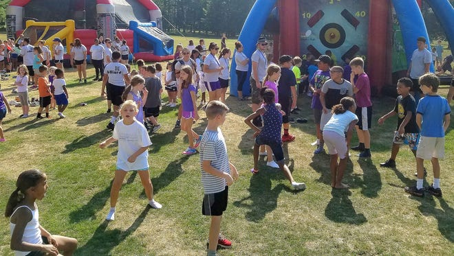 Children in the Chemung County Youth Bureau's Summer Cohesion program take part in the Bobby K Fun Days during Youth Camp on Harris Hill.