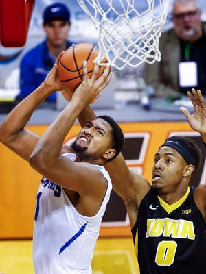 University of Memphis Dedric Lawson (left) drives to the basket against Iowa University guard Ahmad Wagner (left) during second half action of the third place game at the Emerald Coast Classic in Niceville, Florida.