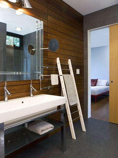The toilets in most of the 5½ baths are mounted to the walls, not the floor.