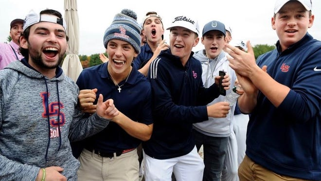 Weston Jones (center, white hat) will get a chance to defend his Division 1 individual golf title on Nov. 1 as he will play in a state-wide golf tournament hosted by Shaker Hills Country Club in Harvard.