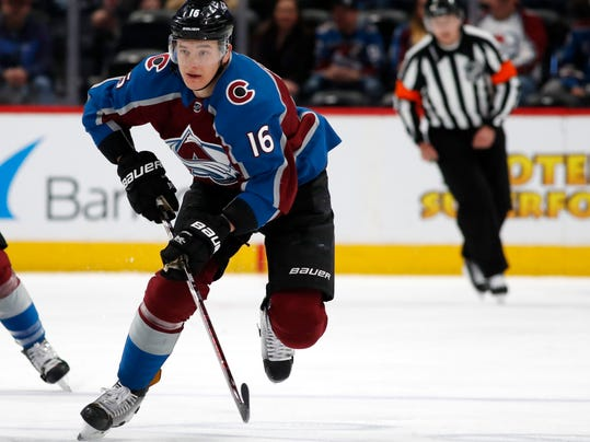 Colorado Avalanche defenseman Nikita Zadorov drives downice with the puck against the Nashville Predators in the first period of an NHL hockey game Sunday, March 4, 2018, in Denver. (AP Photo/David Zalubowski)