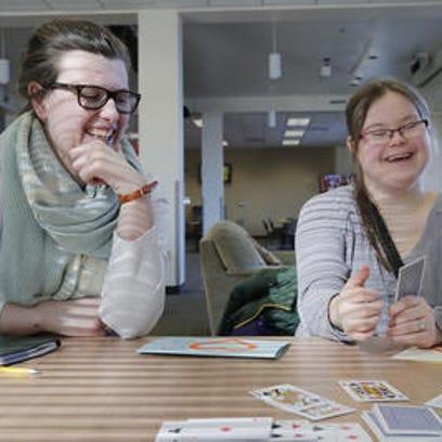St. Norbert junior Shannon Salter (left) plays cards