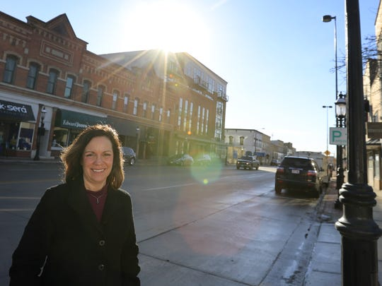 Definitely De Pere Executive Director Tina Quigley stands on North Broadway in De Pere on Jan. 26, 2018.