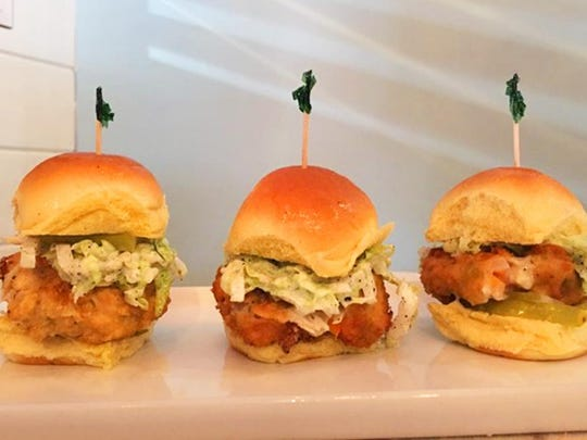 Some of the dishes at Fork + Flask at Nage include country fried chicken sliders on potato rolls as well as hoisin Sriracha wings.