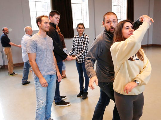 Dance instructor Allen Nugent demonstrates a dance