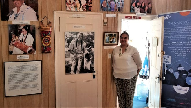 Loren Spears stands by a display inside the Tomaquag Museum in Exeter, Rhode Island. Spears, who is the museum's executive director, is an advocate for sharing a more complete and accurate accounting of Native American history, including in schools.