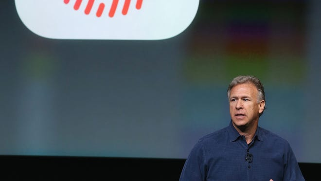 Apple SVP Phil Schiller introduces the new iPhone 5S, Sept. 10, 2013 in Cupertino, California.