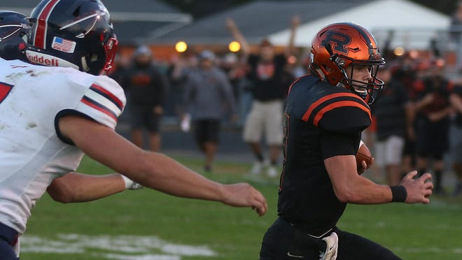 Ridgewood's Gabe Tingle runs for a touchdown during a game with Indian Valley.
