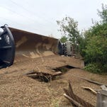 A truck hauling 27 tons of gravel rolled onto its side Tuesday morning at the intersection of Taft Hill and Drake roads in Fort Collins.