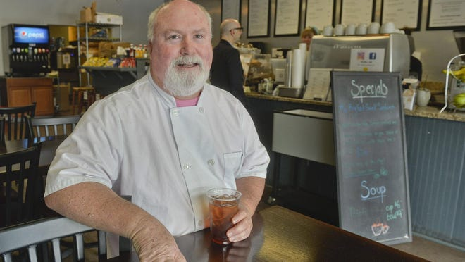 Johnny Baker, co-owner of Bar Food and Coffee Deli in midtown, died on Monday after contracting COVID-19.