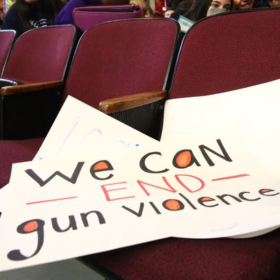 A student's sign for the walk-in assembly for gun violence
