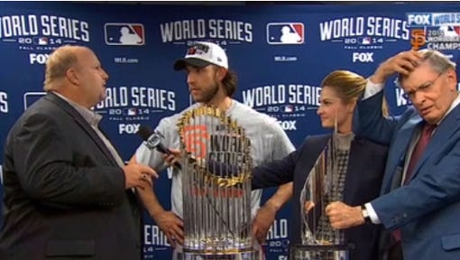 In this screen grab, Rikk Wilde, left, presents a 2015 Chevrolet Colorado to Madison Bumgarner, center, as Erin Andrews holds the Fox Sports microphone. Bud Selig is at far right.
