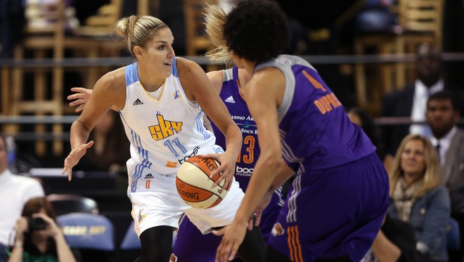 The Sky's Elena Delle Donne drives to the basket while defended by the Mercury's Penny Taylor (13) and Candice Dupree (4) during the first quarter Friday.