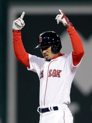 Mookie Betts led the American League in batting, slugging and runs scored in 2018.
