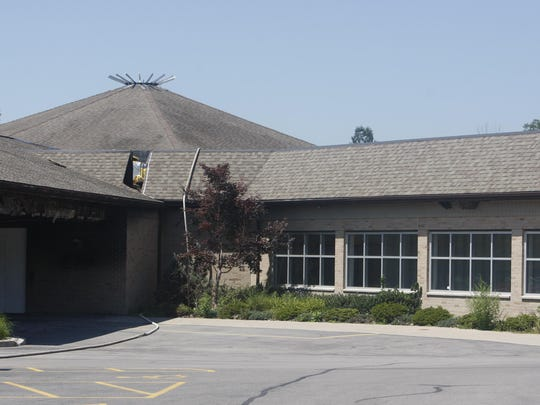 The hole cut in the roof at Saint Pius Tenth is to show the separation from the building on the right, which is being saved.