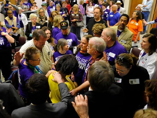 Supporters of Insure Tennessee pray with each other on March 31 following the Senate Commerce and Labor Committee voting 2-6-1 against a resolution to allow Gov. Bill Haslam to implement Insure Tennessee, his controversial health care plan.