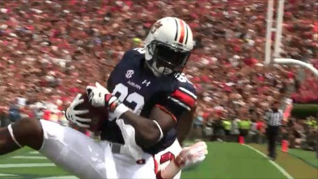 Auburn receiver Melvin Ray forced overtime with a 10-yard touchdown catch with 39 seconds left in regulation.