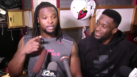 Arizona Cardinals teammates Ed Stinson (Alabama) and Jaron Brown (Clemson) talk about Monday's national championship game between the second-seeded Crimson Tide (13-1) and top-seeded Tigers (14-0).