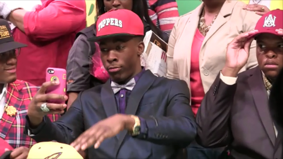 Carver senior Xavier Lane dances during National Signing Day on Wednesday.