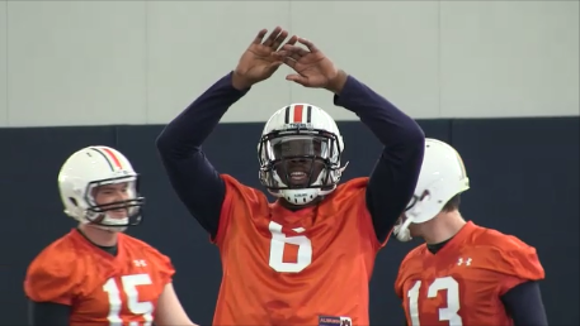 Montgomery native Jeremy Johnson shouts at teammate during spring practice Tuesday.