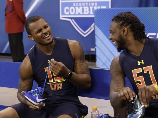 Clemson quarterback Deshaun Watson and Clemson wide receiver Mike Williams share a laugh at the NFL Scouting Combine on March 4.