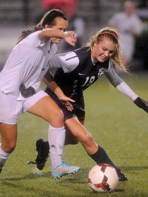 Granville midfielder Nikki Cox tries to get around McNicholas defender Michaela Shepherd during a state semifinal game at West Carrollton High School. The Blue Aces lost to the Rockets 3-1 on Tuesday.