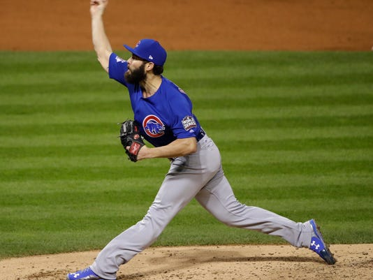 Chicago Cubs starting pitcher Jake Arrieta throws during the second inning of Game 2 of the Major League Baseball World Series against the Cleveland Indians Wednesday, Oct. 26, 2016, in Cleveland. (AP Photo/Gene J. Puskar)