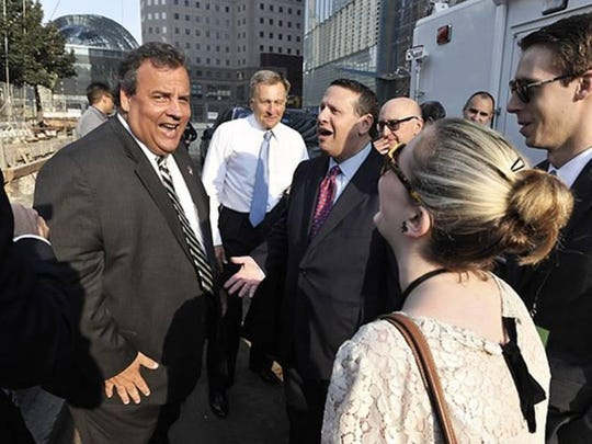 Gov. Chris Christie shares a laugh with David Wildstein during a break in 9/11 ceremonies in New York City on Sept. 11, 2013. Wildstein testified that Christie was told of the Bridgegate closings affecting Fort Lee during that event.