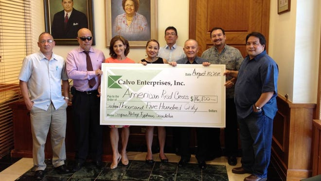 Calvo Enterprises on Aug. 10 presented a $16,500 check to the American Red Cross for typhoon relief efforts in Saipan. From left are: Paul Leon Guerrero, CFO, Calvo's Insurance; Raymond Martinez, assistant general manager, Calvo's Insurance; Kathy Sgro, executive vice president, Pay-Less Supermarkets; Chita Blaise, American Red Cross Guam chapter CEO; Frank Campillo, health plan administrator, Calvo's SelectCare; Paul M. Calvo. president and director, Calvo's Insurance; Paul A. Calvo, executive vice president and general manager, Calvo's Insurance; John T. Calvo, general manager, Mid Pac Distributors.