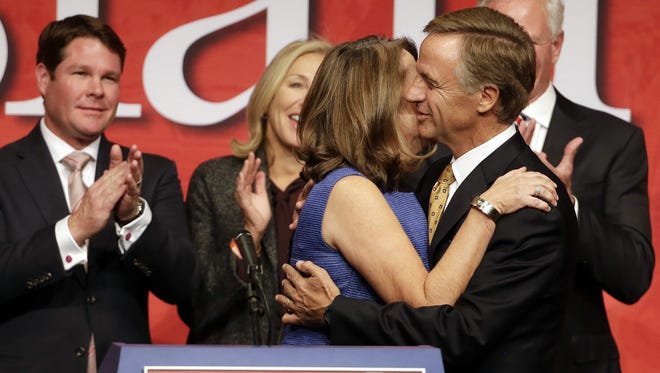 Tennessee Gov. Bill Haslam hugs his wife, Crissy, as he arrives to speak to supporters in Nashville after being re-elected.