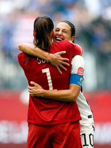 U.S. midfielder Carli Lloyd (10) celebrates with goalkeeper