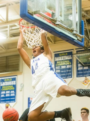 Stephen Decatur forward Keve Aluma (44) goes vertical for a dunk against Washington on Thursday, December 17th at Stephen Decatur High School in Berlin.