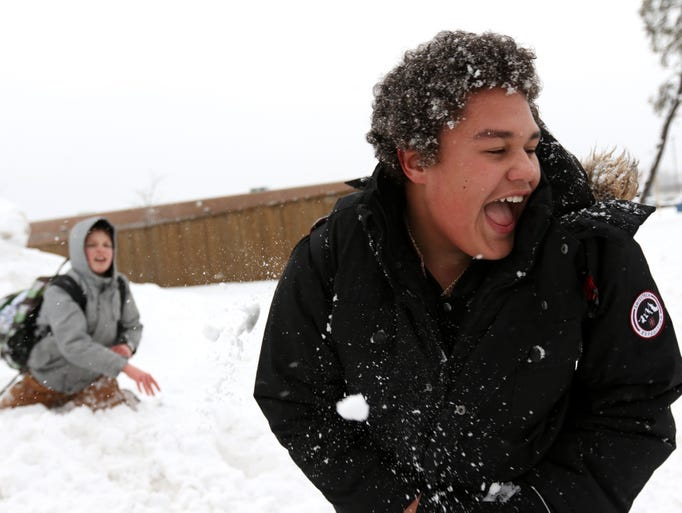 Kolbin Laur, 12, erupts with laughter as he gets hit