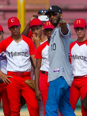 Cuban-born Alexei Ramirez, who plays for the Chicago White Sox, directs players during a clinic Thursday in Matanzas Cuba.