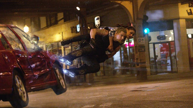 "Channing Tatum and Mila Kunis in a scene from ""Jupiter Ascending,"" an original science fiction epic adventure from Lana and Andy Wachowski."