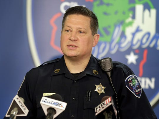 Appleton police Sgt. Dave Lund speaks to the press