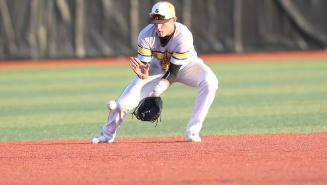 Adam Schneider fields a ground ball against Waterloo West High School in this file photo.