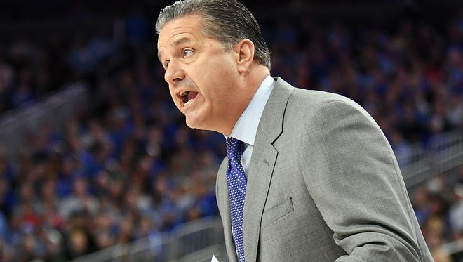 Dec 17, 2016; Las Vegas, NV, USA;  Kentucky Wildcats head coach John Calipari talks to a player on the floor during a game against the North Carolina Tar Heels at T-Mobile Arena. Mandatory Credit: Stephen R. Sylvanie-USA TODAY Sports
