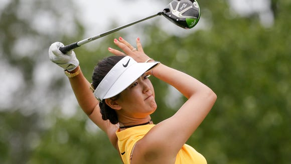 Michelle Wie watches her tee shot on the eighth hole