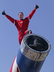"""David """"the Bullet"""" Smith on the barrel of his cannon chatting to the crowd and posing before his launch."""