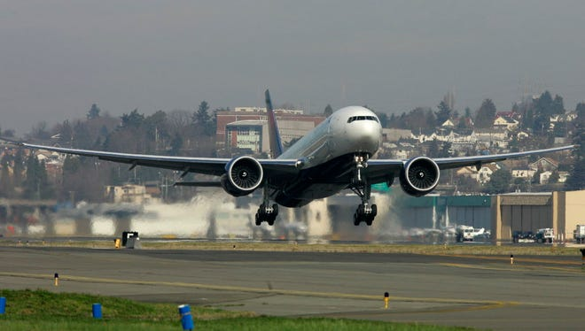 A Boeing 777-200LR purchased by Delta Air Lines Inc. takes off Feb. 29, 2008 from Boeing Field in Seattle.