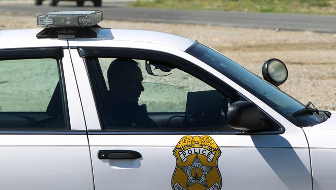 Indianapolis Metropolitan Police Department patrols a parking lot on the corner of East 38th Street and Meadows Drive on Sept. 24, 2013. Charlie Nye / The Star.
