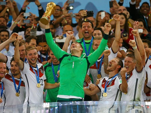 Germany goalkeeper Manuel Neuer lifts the trophy.