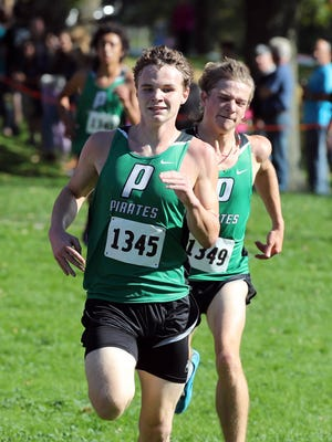 Port Washington's Brett Grisar edges teammates Miles Stimac  and Isaiah Holland (background) to finish second in the boys Division 2 WIAA sectional race on Saturday at Lincoln Park.