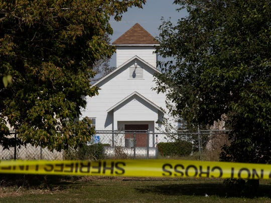 Crime scene tape seen surrounding the shooting scene at the First Baptist Church in Sutherland Springs on Nov. 6, 2017.